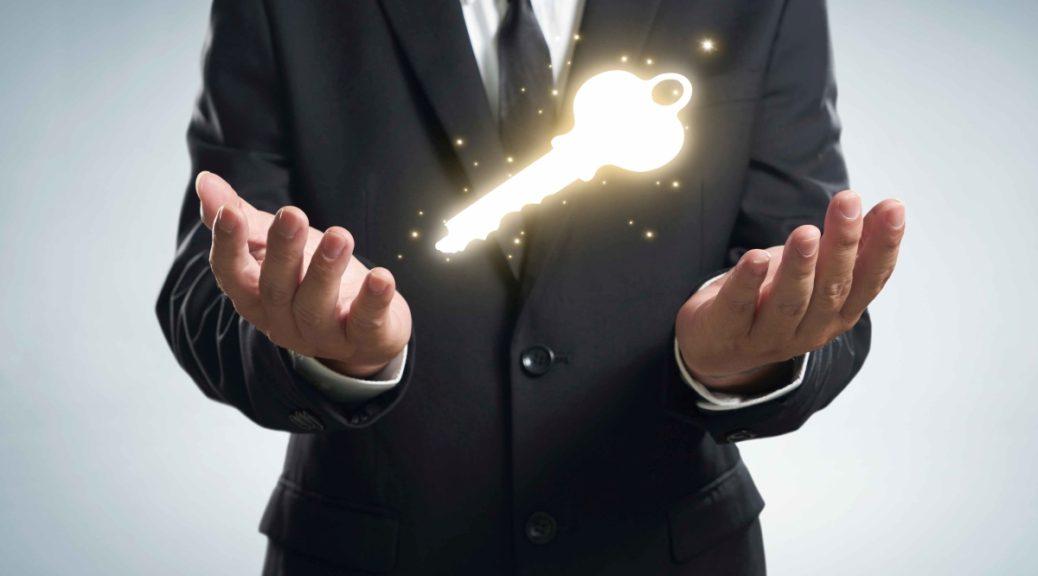 golden key floating between man's hands showing opportunity